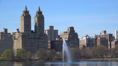 San Remo apartments & JKO Reservoir from NYC Central Park. USA Stock Footage