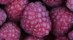Fresh, ripe, juicy raspberries rotate. Red raspberries clockwise rotation Stock Footage