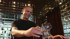 Professional bartender prepares Sambuca at the bar Stock Footage