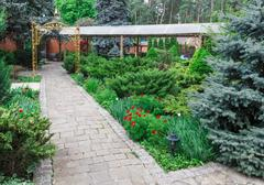 Landscape design, evergreen bushes and path Stock Photos