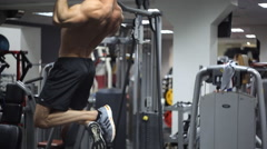 Male with an athletic build exercising on bar at gym - stock footage