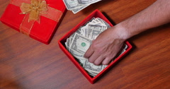 Hidden Present Box of US Currency - stock footage