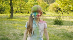 Happy, smeared with colours of Holi girlfriend hugging and laughing. Stock Footage