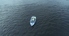 Boat floats on the river aerial view Stock Footage