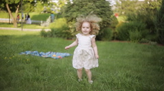curly girl in a summer Park jumps - stock footage