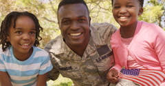 Soldier man and his children looking at camera Stock Footage