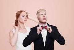 Well-dressed couple in luxury clothes isolated Stock Photos