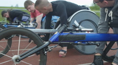 4K Disabled wheelchair athletes competing in a race wait at starting line Stock Footage