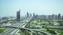 Wide-angle shot of traffic on Sheik Zayed road towards downtown Dubai Stock Footage
