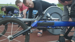4K Disabled wheelchair athletes competing in a race wait at starting line - stock footage