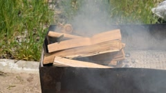 Burning, smoking wood in the metal brazier. Stock Footage
