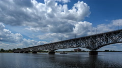 Clouds in the blue sky over a steel bridge Stock Footage