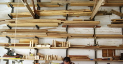 Facing view of carpenter working building a piece of furniture Stock Footage