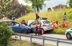 Road accident with rescue workers - stock photo