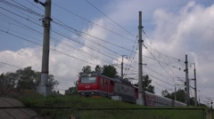 Passenger express train with sleeping cars and electric locomotive - stock footage