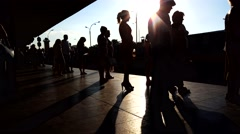 Silhouettes of people on the station platform Stock Footage