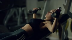 young woman doing a fitness workout with dumbbells - stock footage