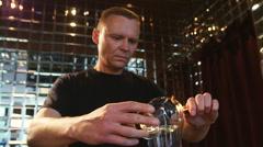 Professional bartender prepares Sambuca in a luxury bar Stock Footage