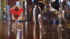 Strawberry margarita cocktail on the bar - stock footage