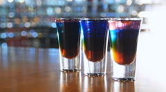 Colorful cocktails in shot at the front bar in the smoke - stock footage