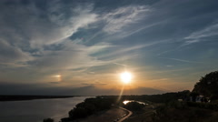 Sunset over the river and the phenomenon of iridescence in the sky Stock Footage