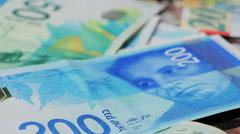 Stack of various of israeli shekel money bills  - Pan left - stock footage