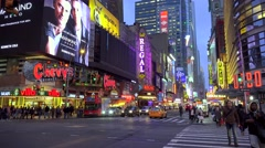 Road traffic at the intersection 42nd St & 8 Ave at night. NYC, USA. - stock footage