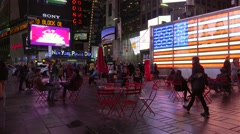 People on Times Square near US Recruiting office at night. NYC, New York, USA. - stock footage