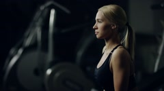 Attractive girl doing squatting with dumbbell Stock Footage