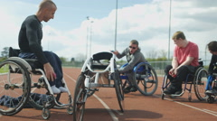 4K Disabled athletes prepare for training session at race track Stock Footage