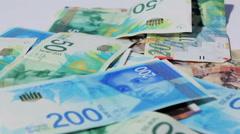 Stack of various of israeli shekel money bills - Tilt down Stock Footage
