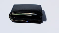 Stack of various of israeli shekel money bills in close black leather wallet Stock Footage