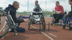 4K Young disabled adults taking advice from experienced athlete in sports sessio Stock Footage