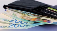 Stack of various of israeli shekel money bills in open black leather wallet - - stock footage