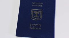 Pannning left of Israeli passport on white background - stock footage