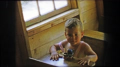 1955: Boy sitting old timey school classroom desk wooden historic building. Stock Footage