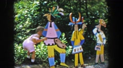 1955: Storyland theme park boy admires Native American indian motif wood Stock Footage
