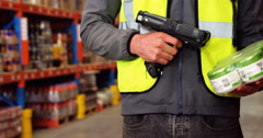 Warehouse worker using a scanner Stock Footage