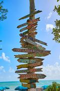 Key West beach distance signs to landmarks - stock photo