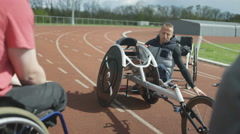 4K Young disabled adults taking advice from experienced athlete in sports sessio - stock footage
