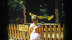 1955: Storyland theme park boy visits animated frog food fairytale story Stock Footage