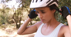 Woman wearing cycling helmet Stock Footage