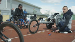 4K Young disabled adults talking to experienced athlete in sports session Stock Footage