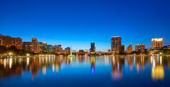 Orlando skyline sunset at lake Eola Florida US - stock photo