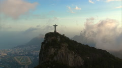 Aerial View of Christ the Redeemer with dramatic clouds, Rio de Janeiro, Brazil. - stock footage