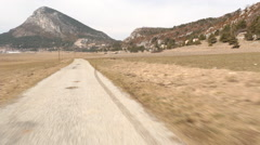 Point of view pov drive on mountain road Stock Footage