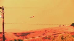 DC10 Drops Retardant on a Wild Fire in California Stock Footage