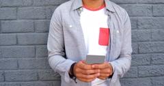 Fashionable man using smartphone Stock Footage