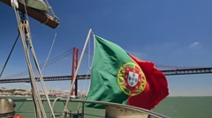 Portuguese flag on a ship on bridge of 25th April background Lisbon Portugal Stock Footage
