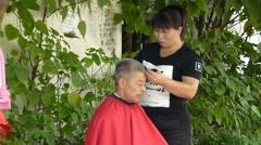 Roadside barber, barber for the elderly Stock Footage